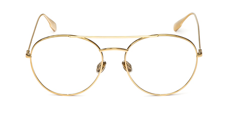 Gold glasses metal in round frame transparent for reading or good eye sight, front view isolated on white background.
