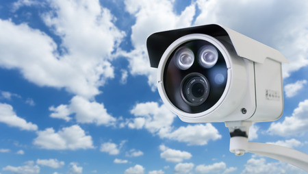 CCTV security camera on blue sky background