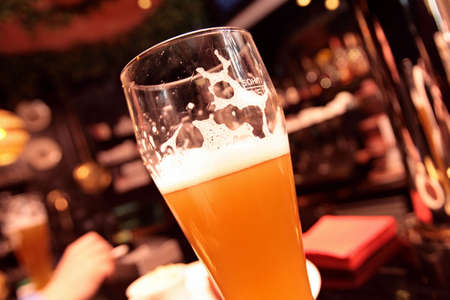 The glass of beer in dark bar Stock Photo