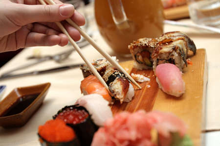 The sushi and chopsticks in japan restaurant photo