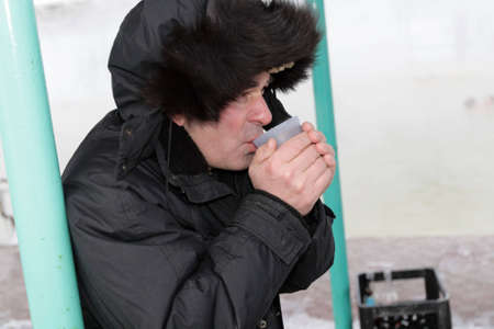 The man drinks a tea in winter Stock Photo - 3199696