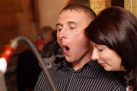 The man and the woman in hookah house photo
