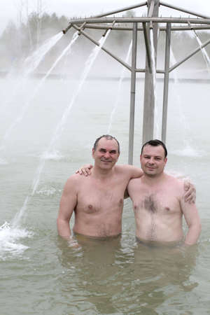 Two smiling men in a thermal spring Stock Photo - 3234733