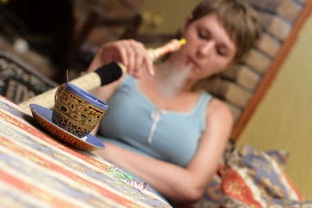 The girl with hookah in a chaikhana photo