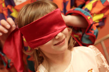 blind child: The girl plays hide-and-seek at home Stock Photo