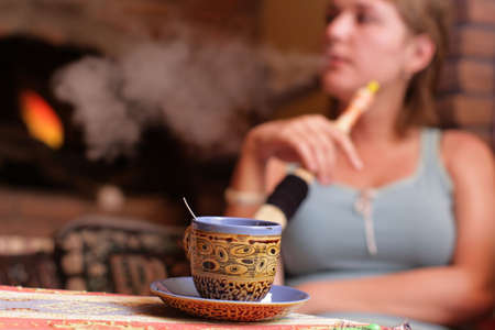 The girl smokes hookah in a turkish cafe Stock Photo