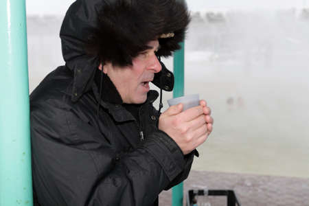 The man drinks a hot tea in winter Stock Photo - 3724636