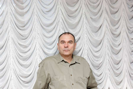 Portrait of serious man on a curtain background Stock Photo - 3790915