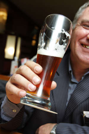 pint: The man in a beerhouse with beer