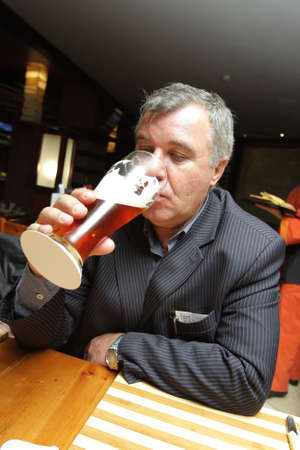 The man in a pub with beer photo