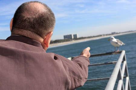A man calls a mew, Pacific Ocean Stock Photo - 4290275