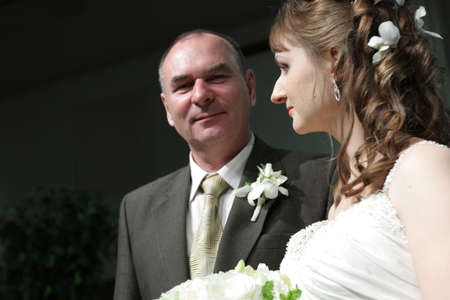 A bride and her father in church photo