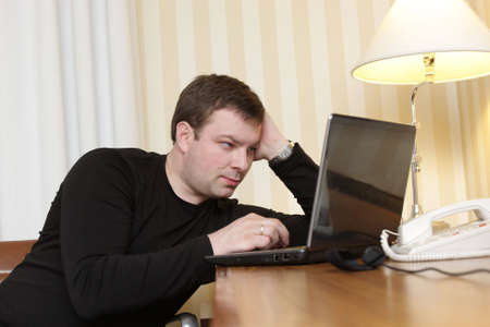 The man watches a film on laptop in a hotel Stock Photo - 4618889