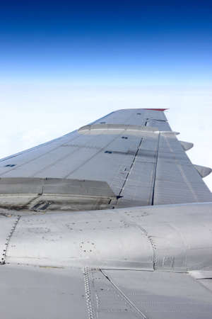 silvery: The silvery wing of a airliner in the sky