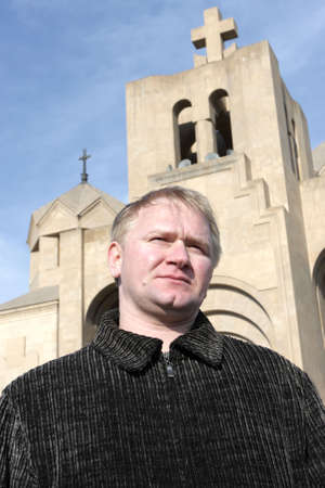 national historic site: The man poses on a church background