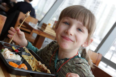 Smiling teen poses in a Japanese restaurant photo