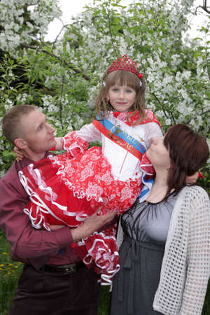 Family poses in a spring park, Russia photo