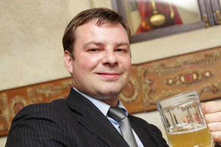 necktie beer: The manager resting after work in a beer restaurant Stock Photo
