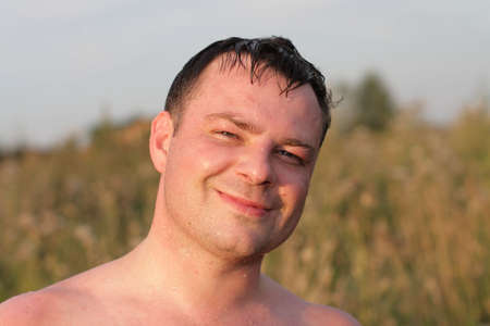 Portrait of a happy man in summer photo