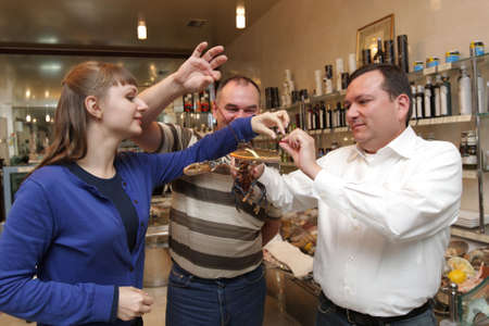 Frends inspect a lobster in a restaurant Stock Photo - 5204642