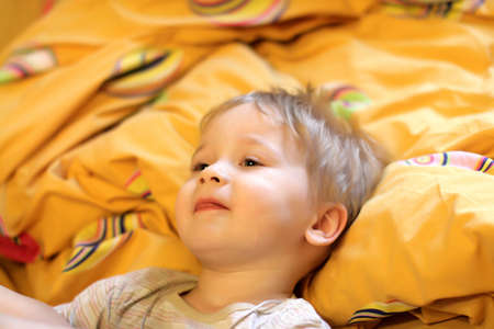 Portrait of the boy on bed after sleep Stock Photo - 5251391