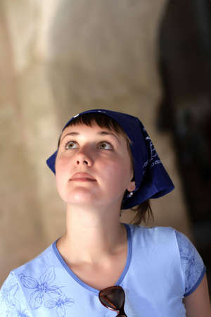 eyes cave: The woman on excursion in ancient church