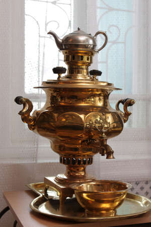 The old copper samovar in a museum photo