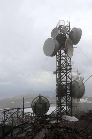 Telecom mast in a fog, Tien Shan, Kyrgyzstan photo