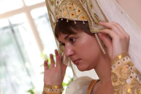 kokoshnik: The young woman tries on a kokoshnik