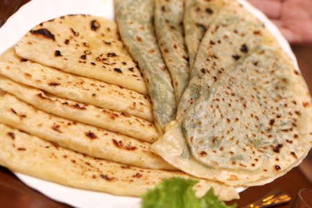 azerbaijani: Cuisine of Azerbaijan - Kutaby with Greens in restaurant