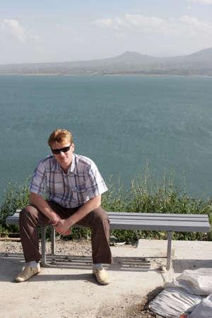 The man resting on bench, Sevan, Armenia Stock Photo - 5452968