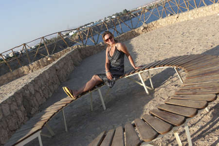 The girl poses on a wooden bench, Egypt photo