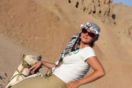 The girl has tour on camel, Egypt photo