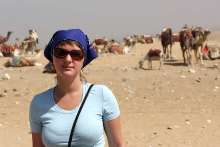 The woman poses on a camels background, Egypt Stock Photo - 5903029