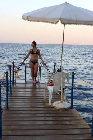 The woman on a dive bridge, Red sea, Egypt Stock Photo - 5979935
