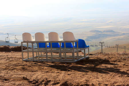 kirgizia: Observer seats on ski resort in Kyrgyzstan in autumn (Bishkek - Osh road)