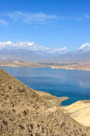 kirgizia: Toktogul Reservoir, located in the Jalal-Abad Province of Kyrgyzstan, is the largest of the reservoirs on the path of the Naryn River. Bishkek - Osh road Stock Photo