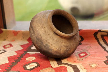 The clay jug on a carpet, Armenia photo