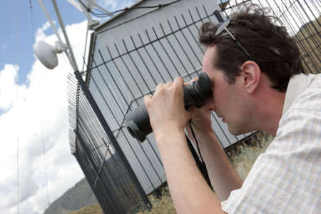 The planner of radio relay link works on telecom site Stock Photo - 6678898