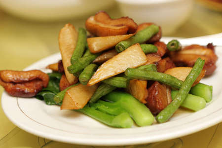Salad with meat and vegetables at chinese restaurant, Beijing photo
