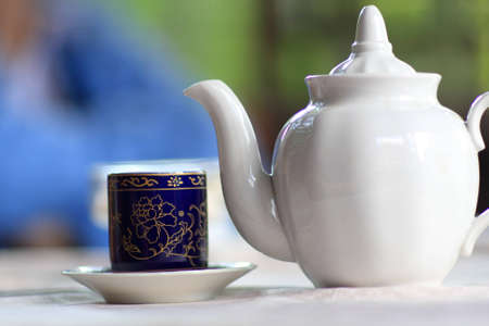 The cup of tea and a white teapot Stock Photo - 7216923