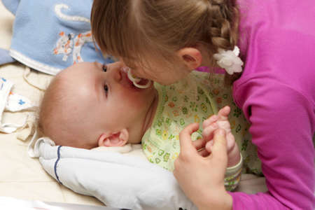 The girl kissing his brother at home Stock Photo - 7350593