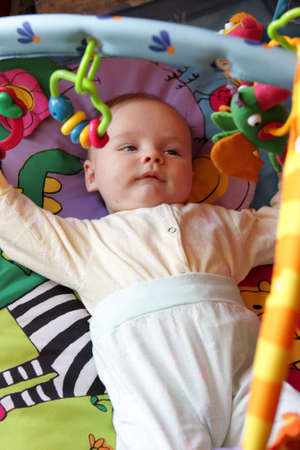 bassinet: The baby is lying on the bassinet