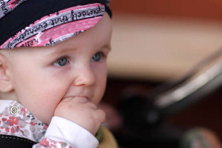 sucks: The funny baby sucks hes fingers outdoor