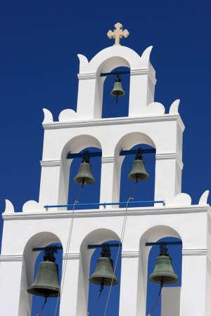 White belfry of greek church at Santorini island, Oia photo