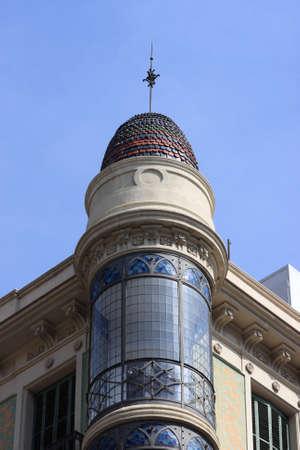 Corner tower of building in Barcelona, Spain photo
