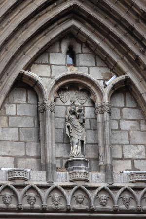 Wall of Catholic cathedral at gothic quarter of Barcelona photo