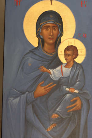 Icon of Mary and Jesus on the wall of greek church Stock Photo