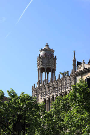 The building behind trees in Barcelona, Spain photo