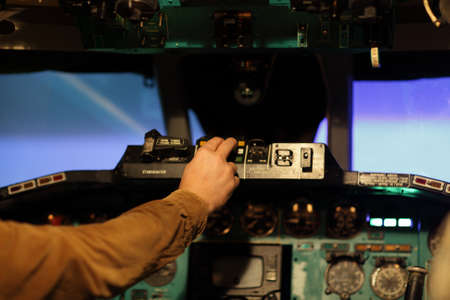 The flight engineer switches on toggle in the airliner